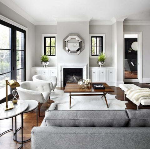 Luxe lounge room with a grey couch and a pair of white tub chairs