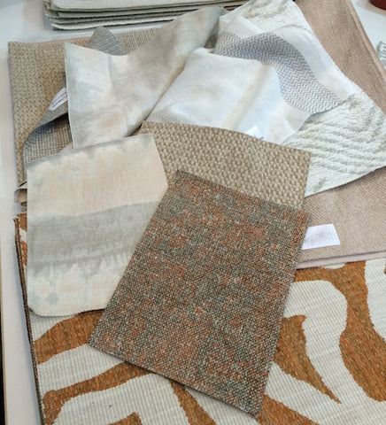 Fabric swatches in warm neutral colours with different textures