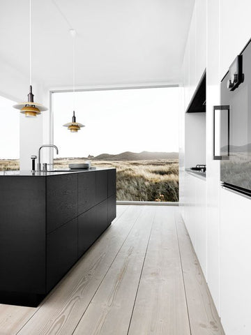 Minimalist kitchen with black and white cabinets