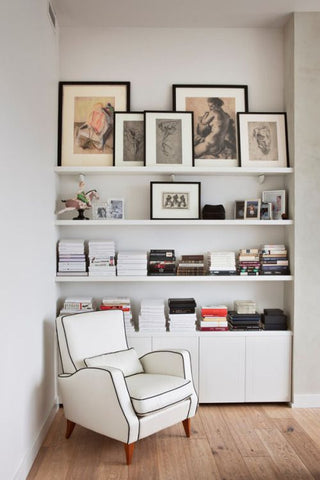 Layered artwork in a reading nook