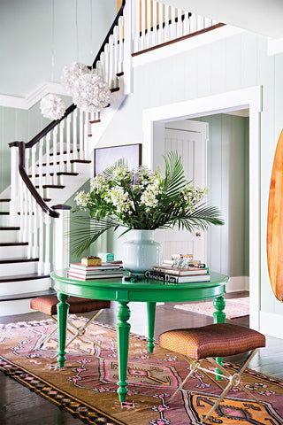 Foyer with staircase and green table