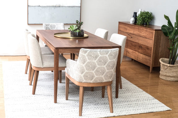 Jervis dining table in Spotted Gum styled with neutral upholstered Kingston dining chairs, Jervis buffet, art, rug and greenery