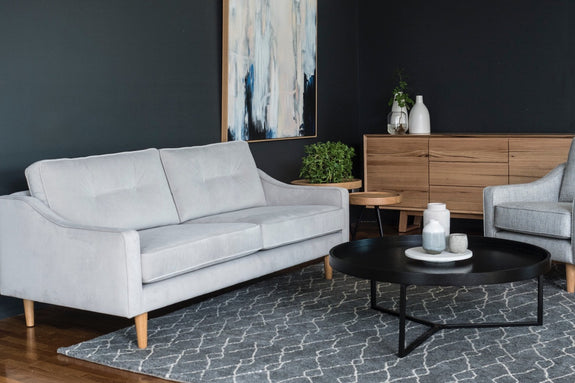 Liza sofa in a 2.5 seat, in a plush light grey velvet styled with the Baxter Buffet, Nordic rug and black round tivoli coffee table.