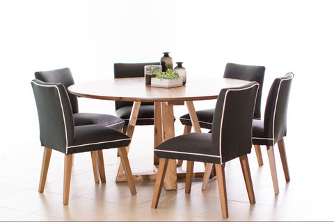 Vista dining table with black and white piped Maison chairs