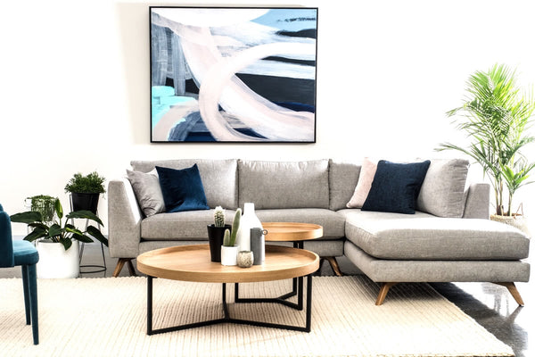 "Grey Bianca chaise lounge sofa with natural oak Tivoli coffee table and side with Abstract ""Airlie"" painting"