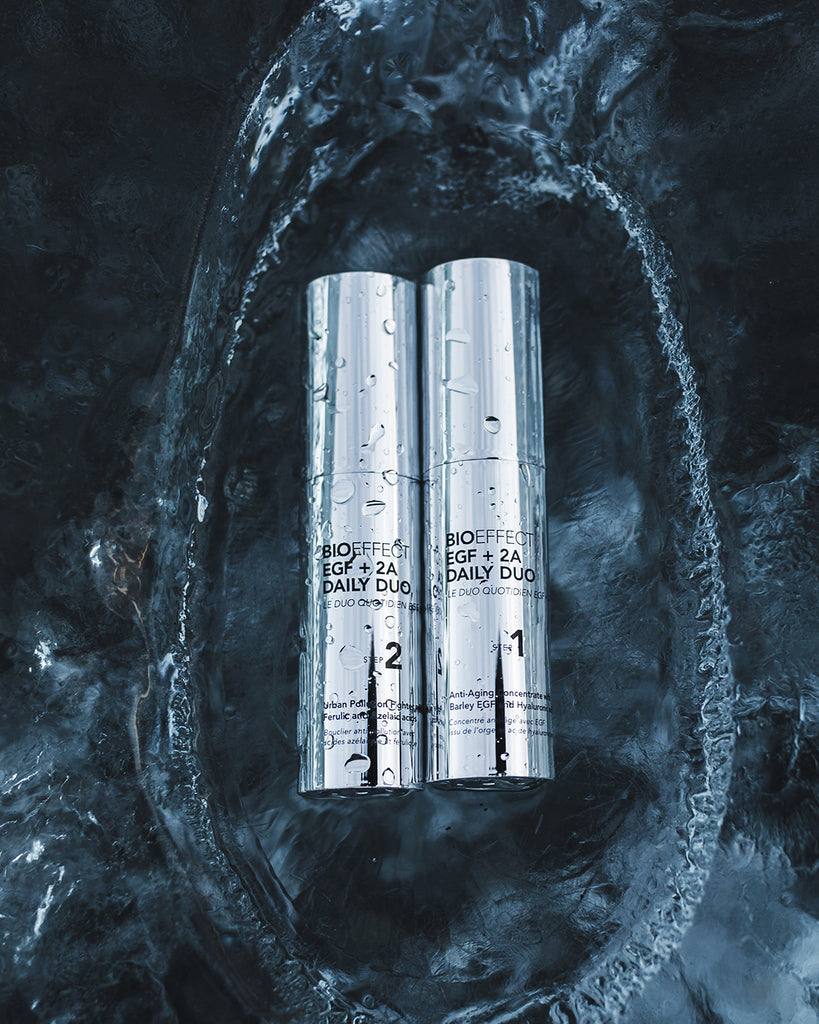 BIOEFFECT EGF + 2A Daily Duo antioxidant skincare products falling into blue-grey water
