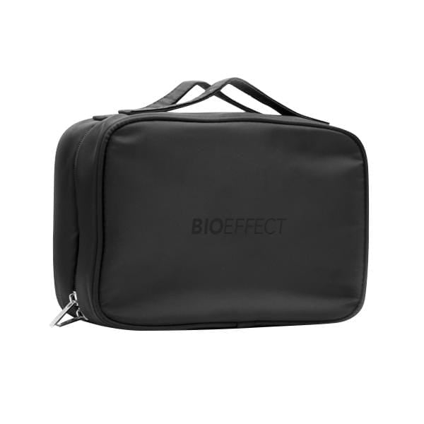The BIOEFFECT branded black travel bag placed on a white surface.