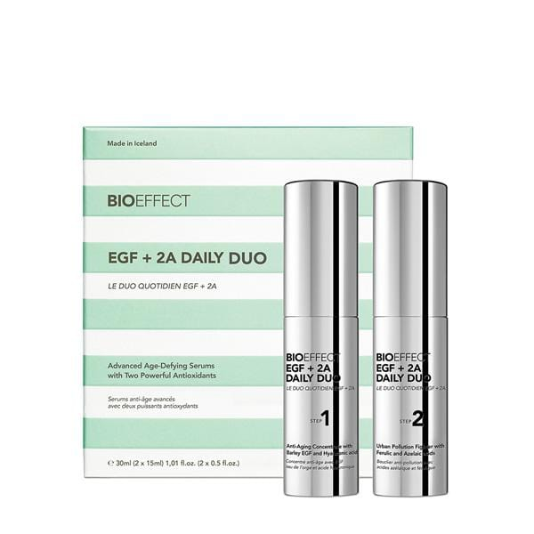 Two silver bottles of BIOEFFECT Anti-Aging Skincare EGF Daily Duo Serum to the right of their green-and white striped package.