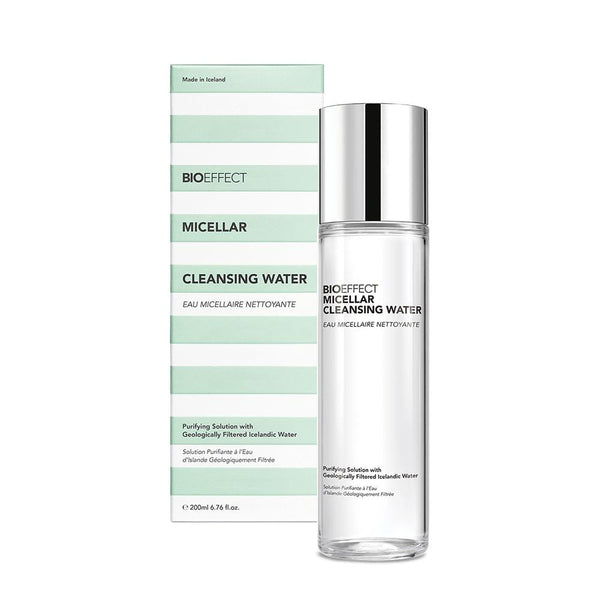 The BIOEFFECT Micellar Cleansing Water bottle placed in front of its green and white striped packaging.