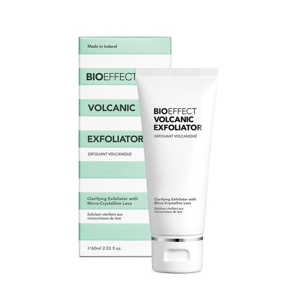 Alt-Text: A bottle of BIOEFFECT Volcanic Exfoliator sitting upright, in front of its green and white striped packaging.
