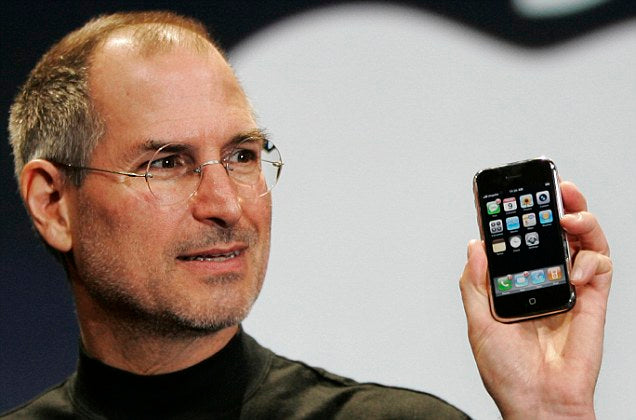 Steve Jobs holding a new Apple iPhone 4