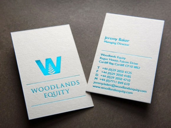 woodlands business cards with blue foil blocking