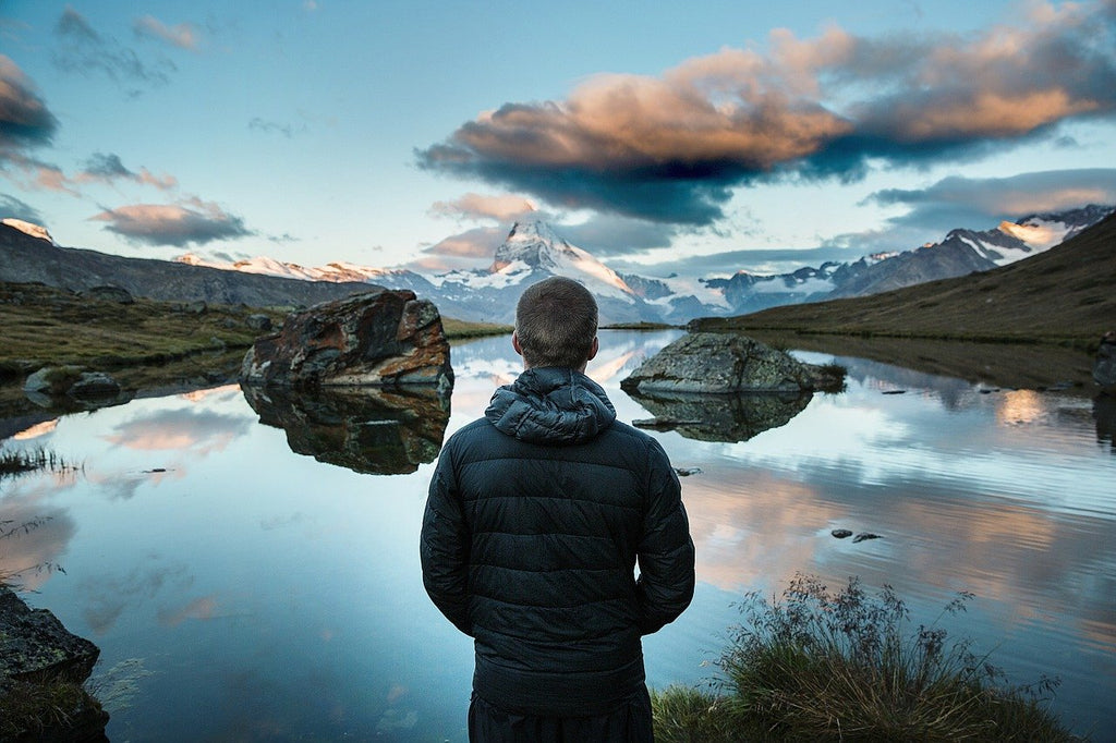 Man overlooking the Scottish Highlands