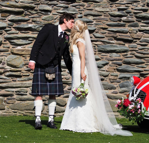 The bride & groom kiss. Photo Stephen Henry