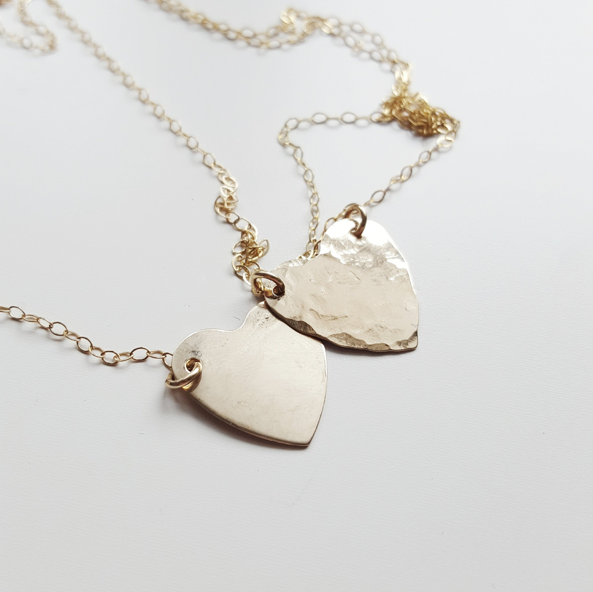 two hammered heart necklaces with chains