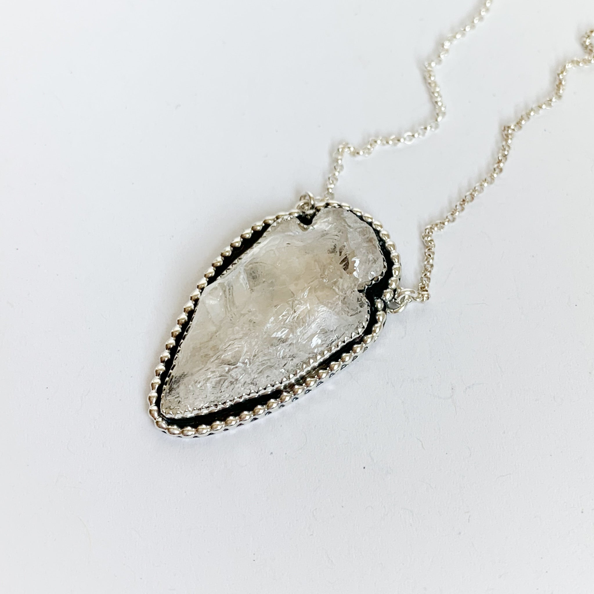 Quartz crystal arrowhead necklace with bead detail
