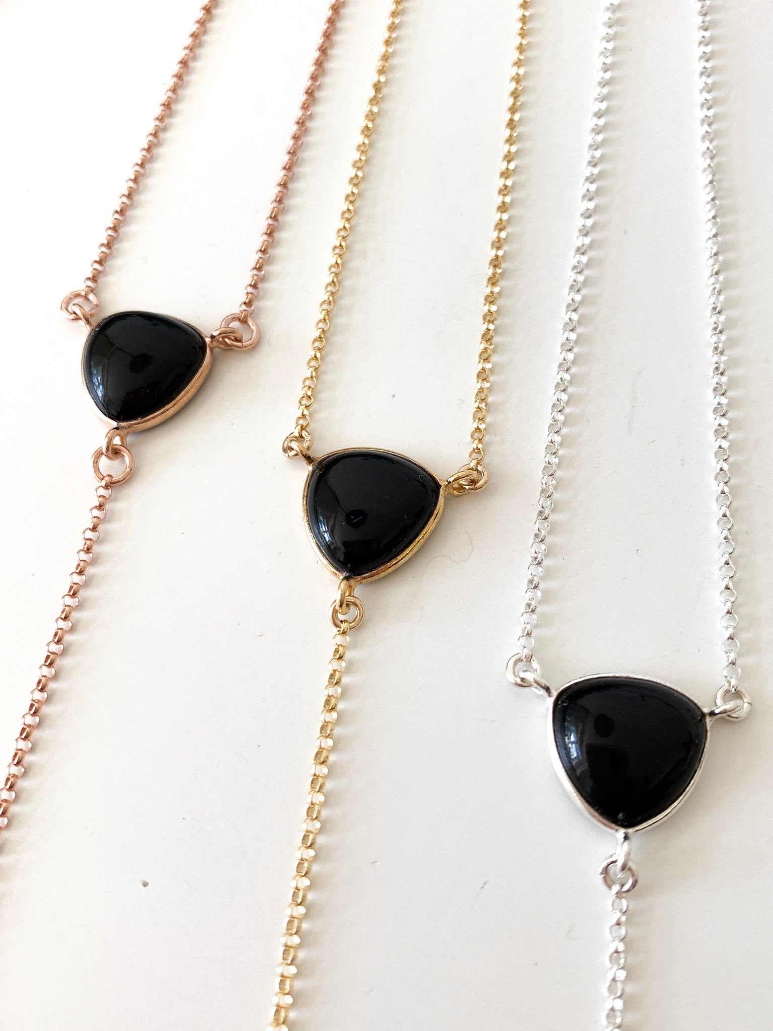 three black onyx stone lariats with rose gold, gold and silver chain options