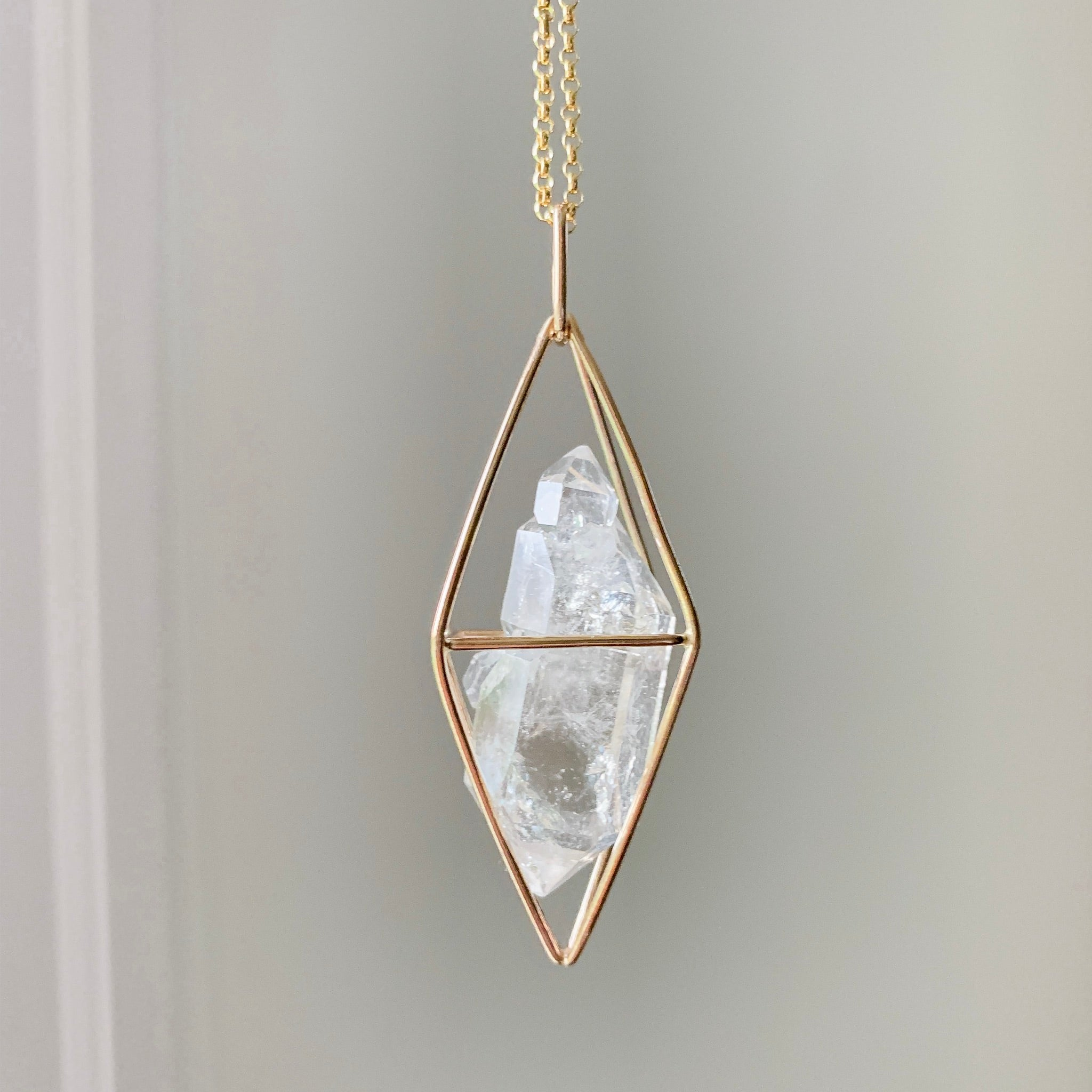 CAGED CRYSTAL - GOLD - SMOKY QUARTZ
