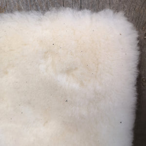 100% shorter wool pile fleece on poly backing