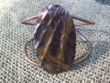 Oval form folded and flame painted copper wire cuff