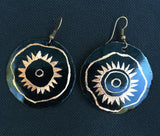 black 1 1/2 inch round earring with etched African design