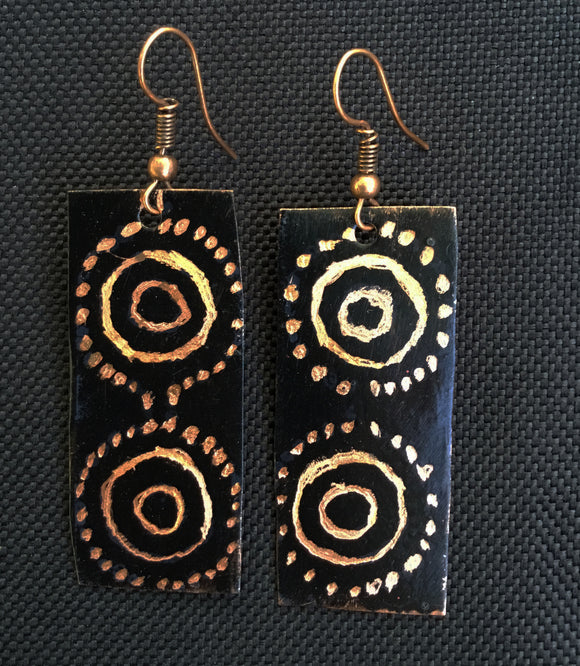 Black circle dots using aborigine pattern. Copper dot shine thru