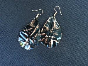 large 2 inch black teardrop earring that has been form-folded to allow copper the shine through