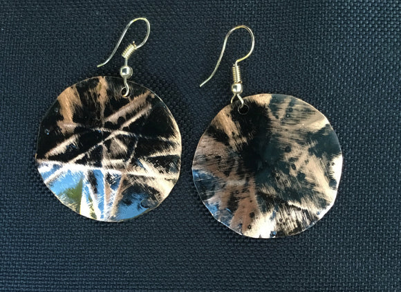 Black round 1 1/4th inch form-folded copper earring