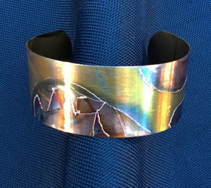 1 inch flamed copper cuff where ever the flame went I etched around that pattern