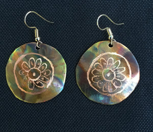 Flamed copper with daisy pattern placed into the center