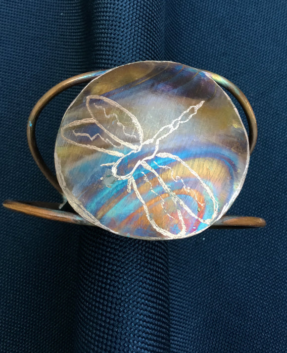 Flame painted with dragonfly etched into the round piece which attached to 2 wires