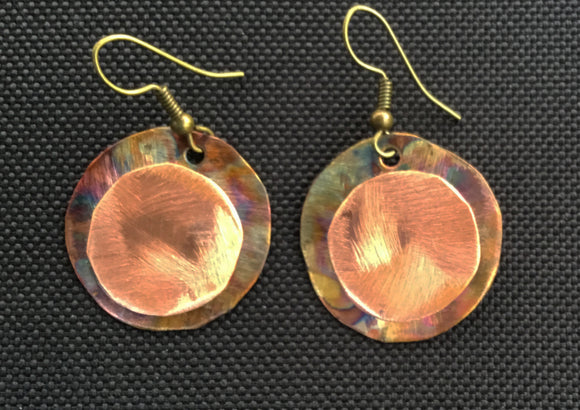 double round copper round earring flamed in back copper on top