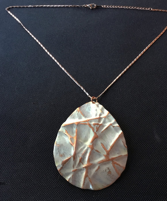 large teardrop on sandstone colored necklace that has been form-folded