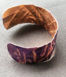 side view of purple 1 inch copper cuff