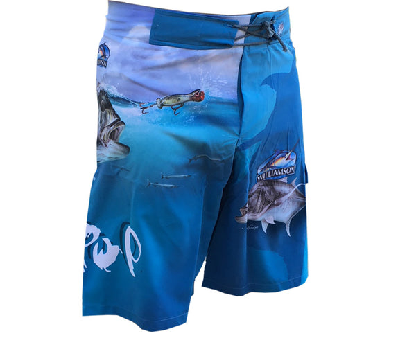 blue board shorts with a GT on it