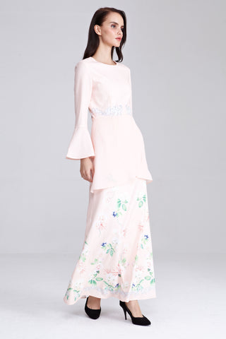 Fadya Peplum Dress with Placement Floral Print in Pastel Peach