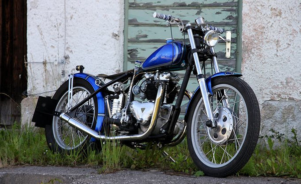 Triumph bobber with pipes photo