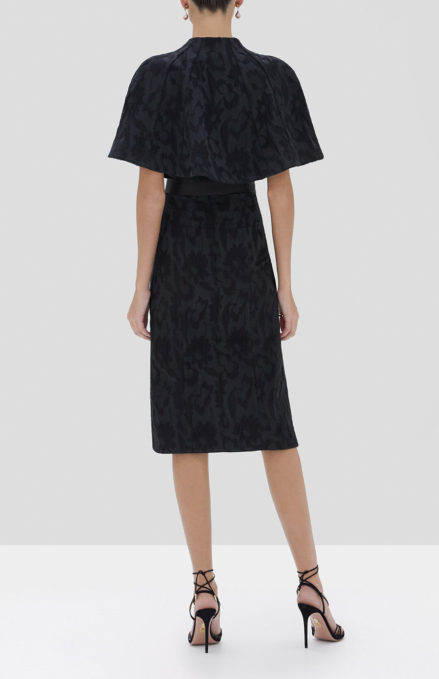 Alexis Fiah Cape and Isotta Dress in Black Floral Jacquard from the Fall Winter 2019 Collection - Rear View