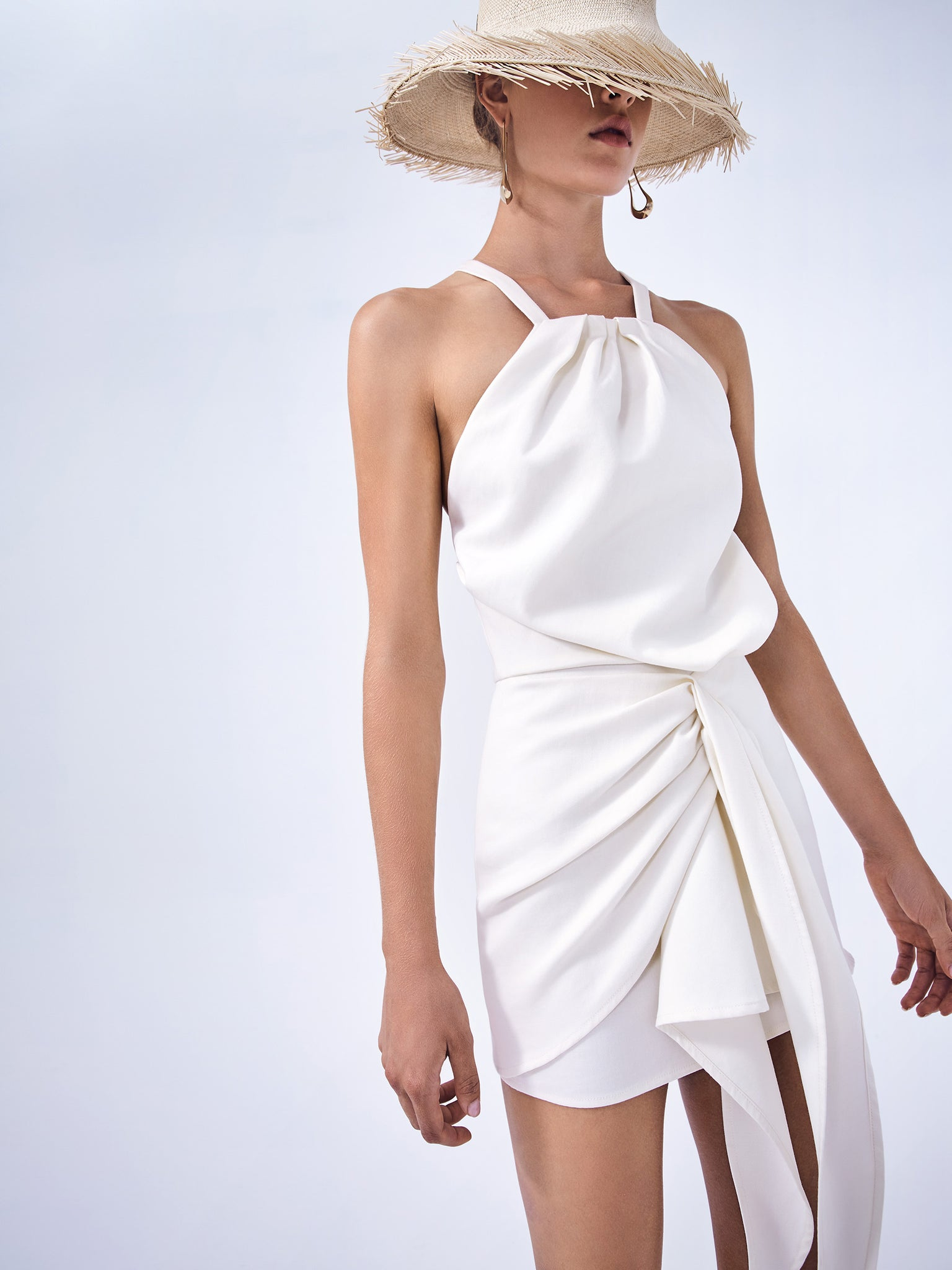 Alexis Adriena mini dress in white. Sarong skirt and halter neckline that criss crosses in the back. - Rear View