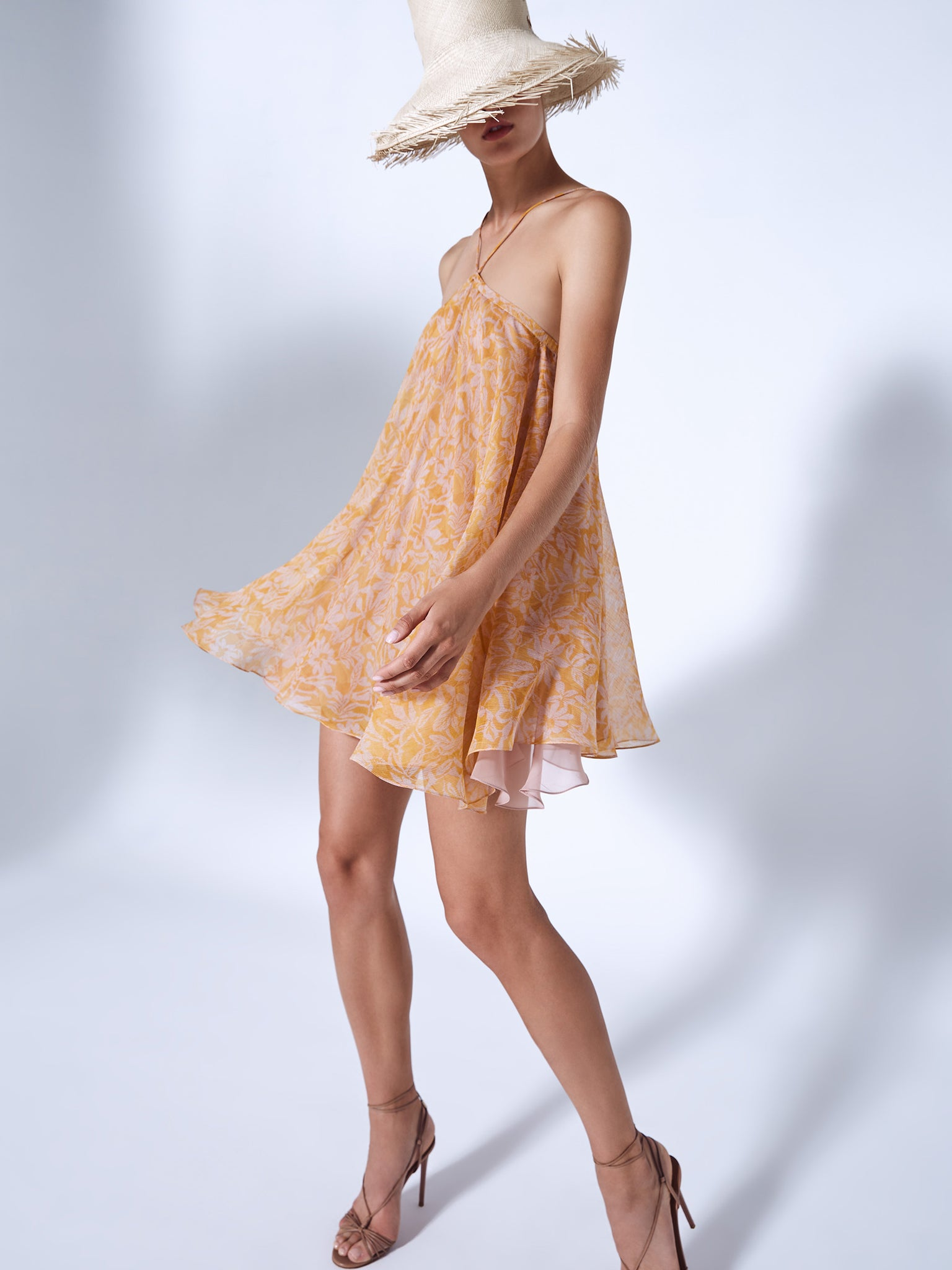 Alexis Amnia swing mini dress in orange and lilac printed chiffon fabric featuring a halter neckline - Rear View
