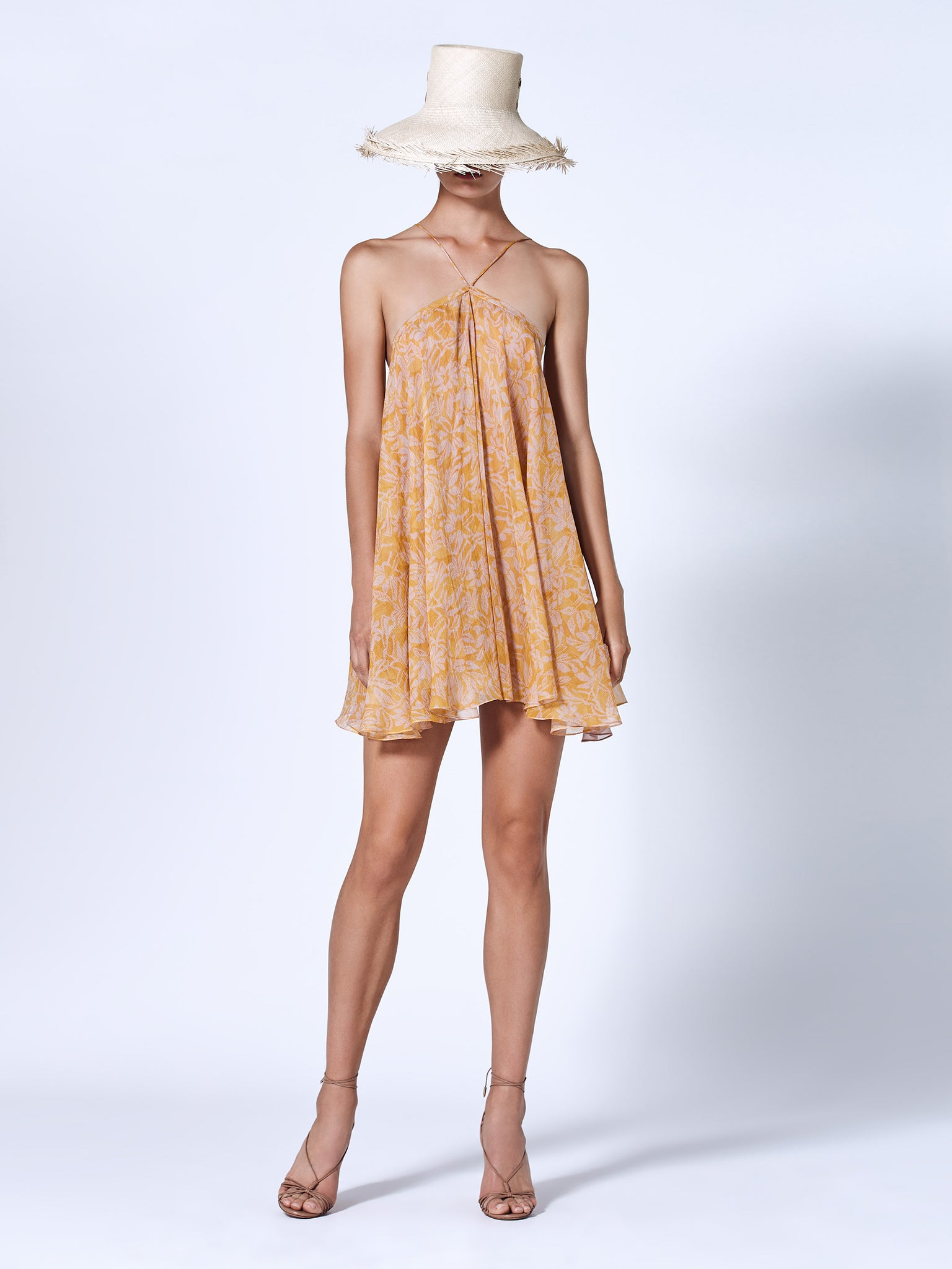 Alexis Amnia swing mini dress in orange and lilac printed chiffon fabric featuring a halter neckline
