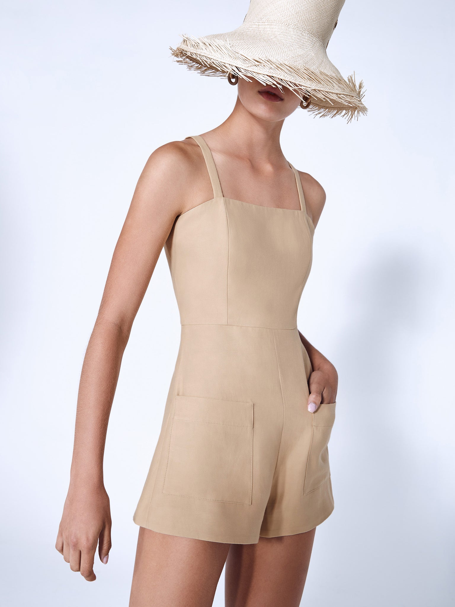 Alexis Arlington romper in beige featuring square neckline and two front pockets - Rear View