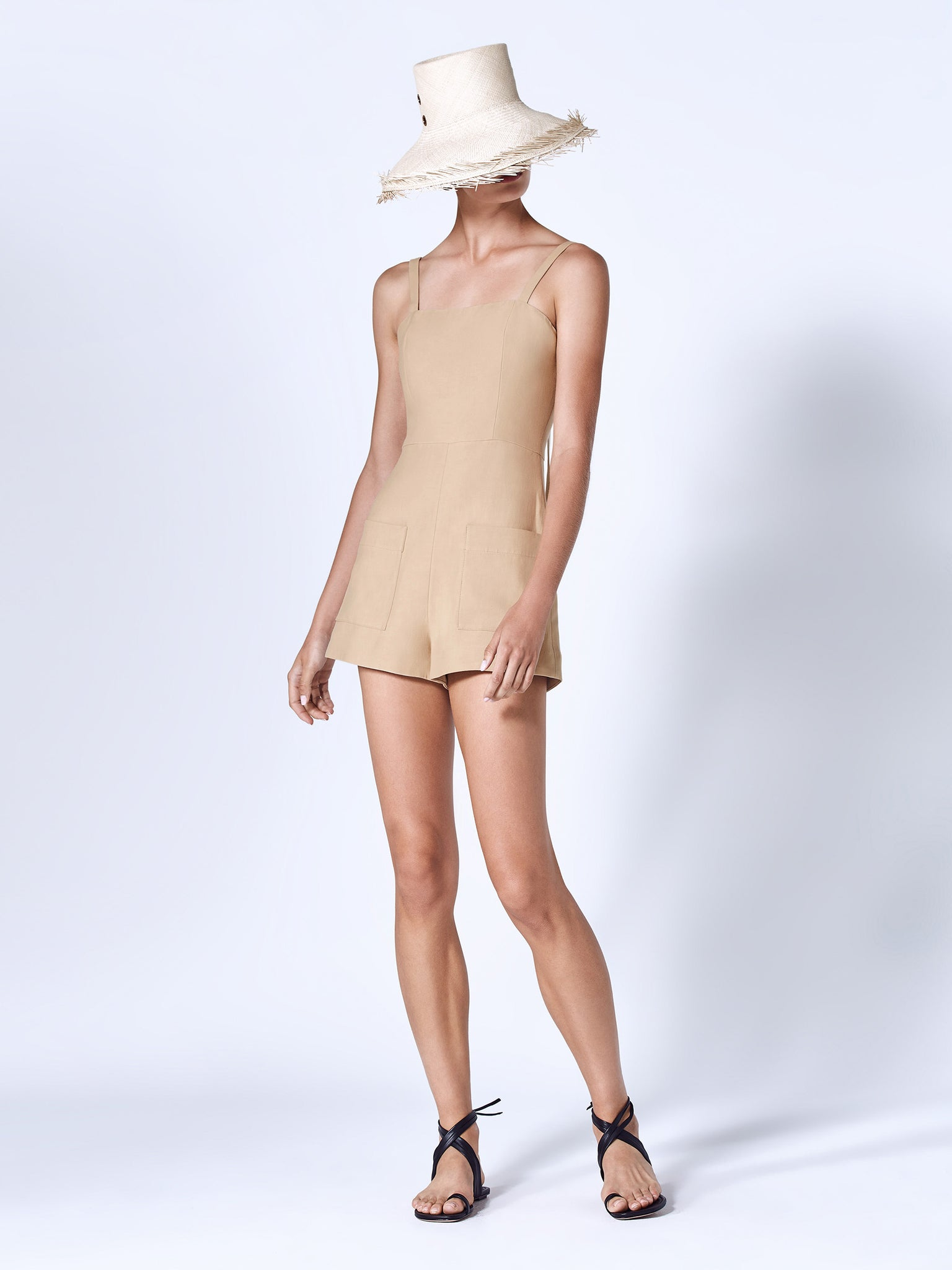 Alexis Arlington romper in beige featuring square neckline and two front pockets