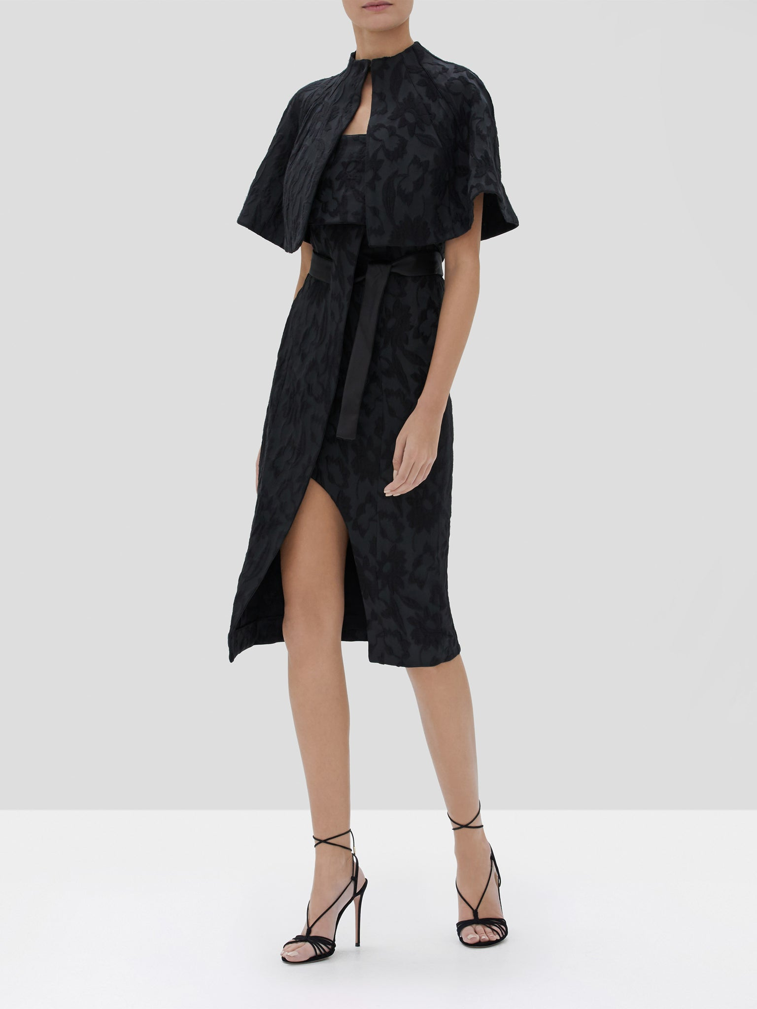 Alexis Fiah Cape and Isotta Dress in Black Floral Jacquard from the Fall Winter 2019 Collection