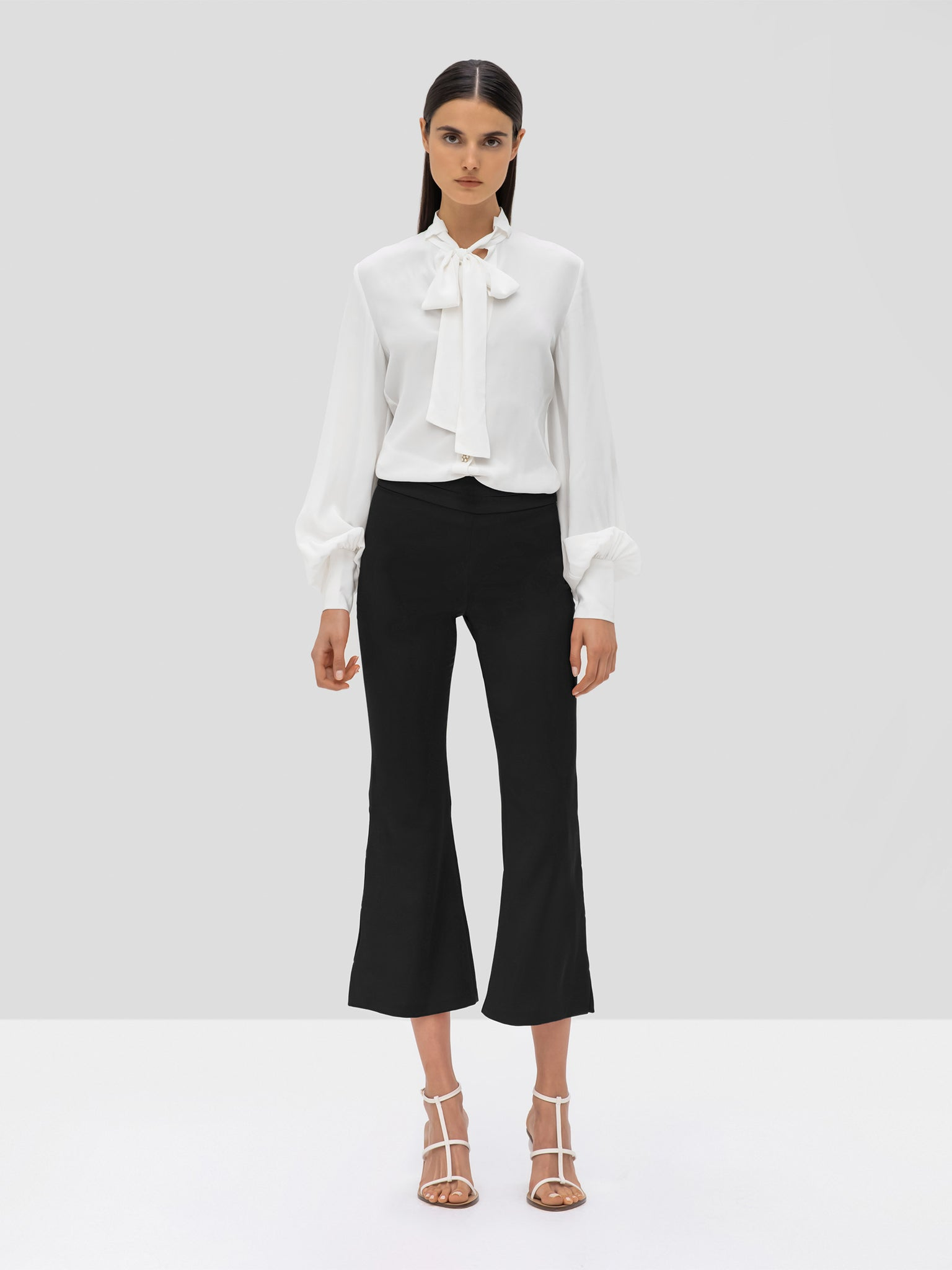 ALEXIS Aruca Top in white and Nadira Pant in Black from the Pre Fall 2019 Ready To Wear Collection