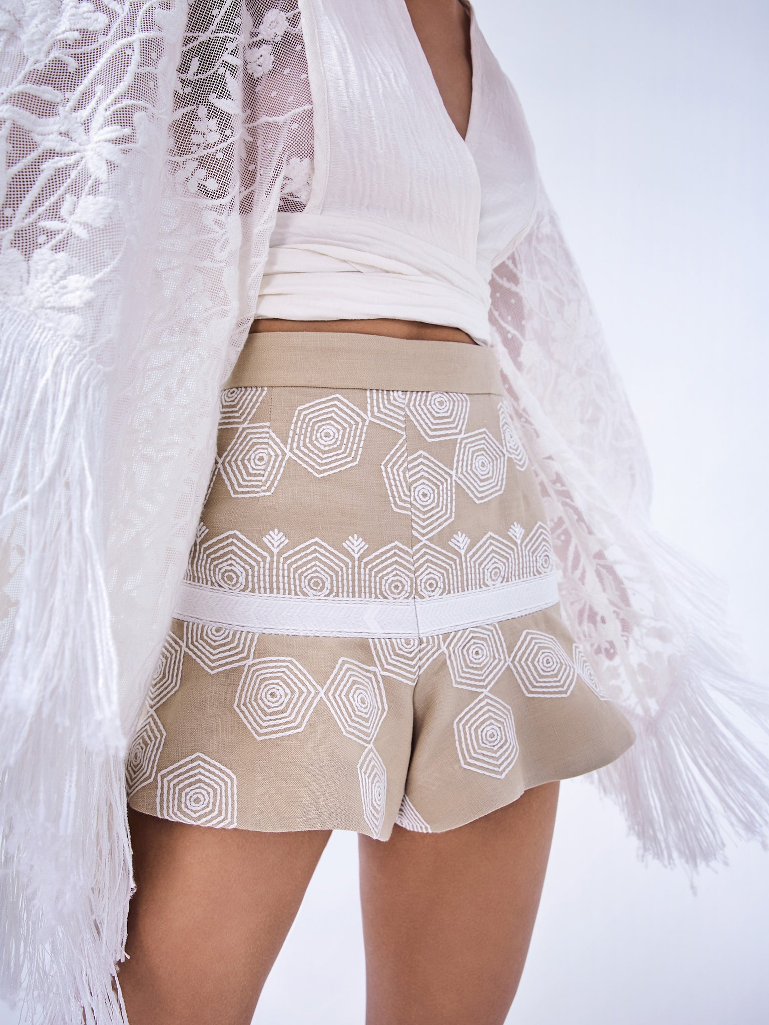 Alexis Acadia Shorts in beige with white embroidery and a wide leg hem - Rear View
