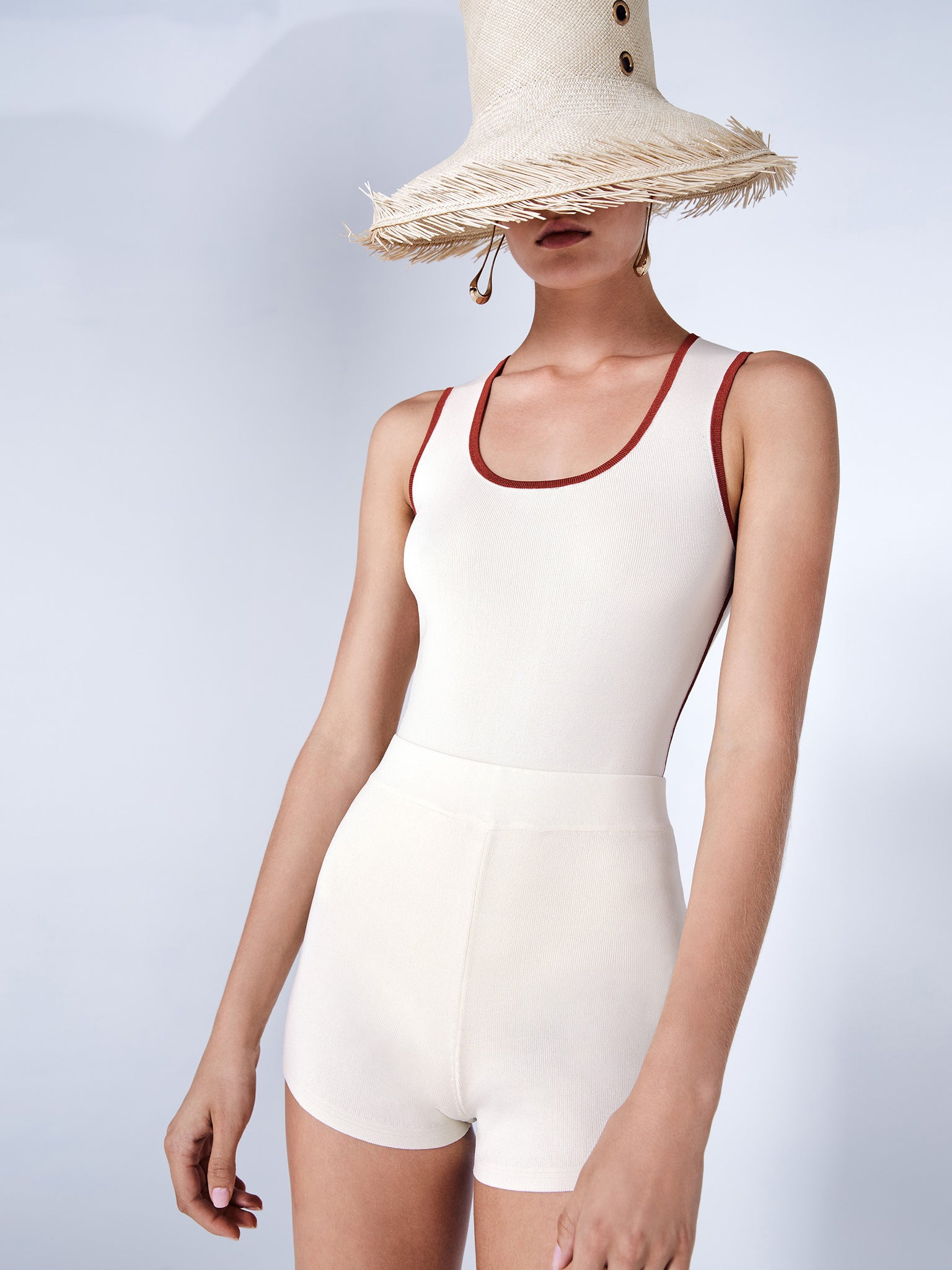 Alexis panya bodysuit in white with redpiping - Rear View