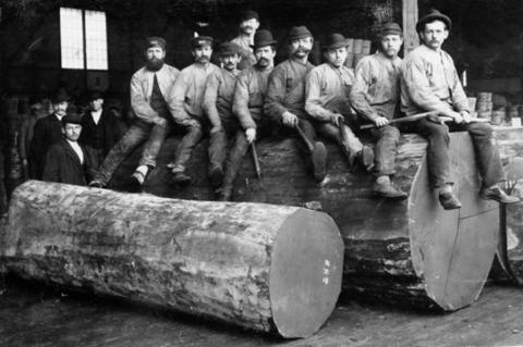 Loggers sitting on log