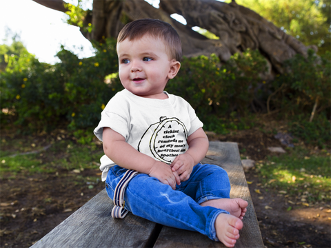 Infant wearing white t-shirt from K.I.D Clothes www.K-I-D-Clothes.myshopify.com