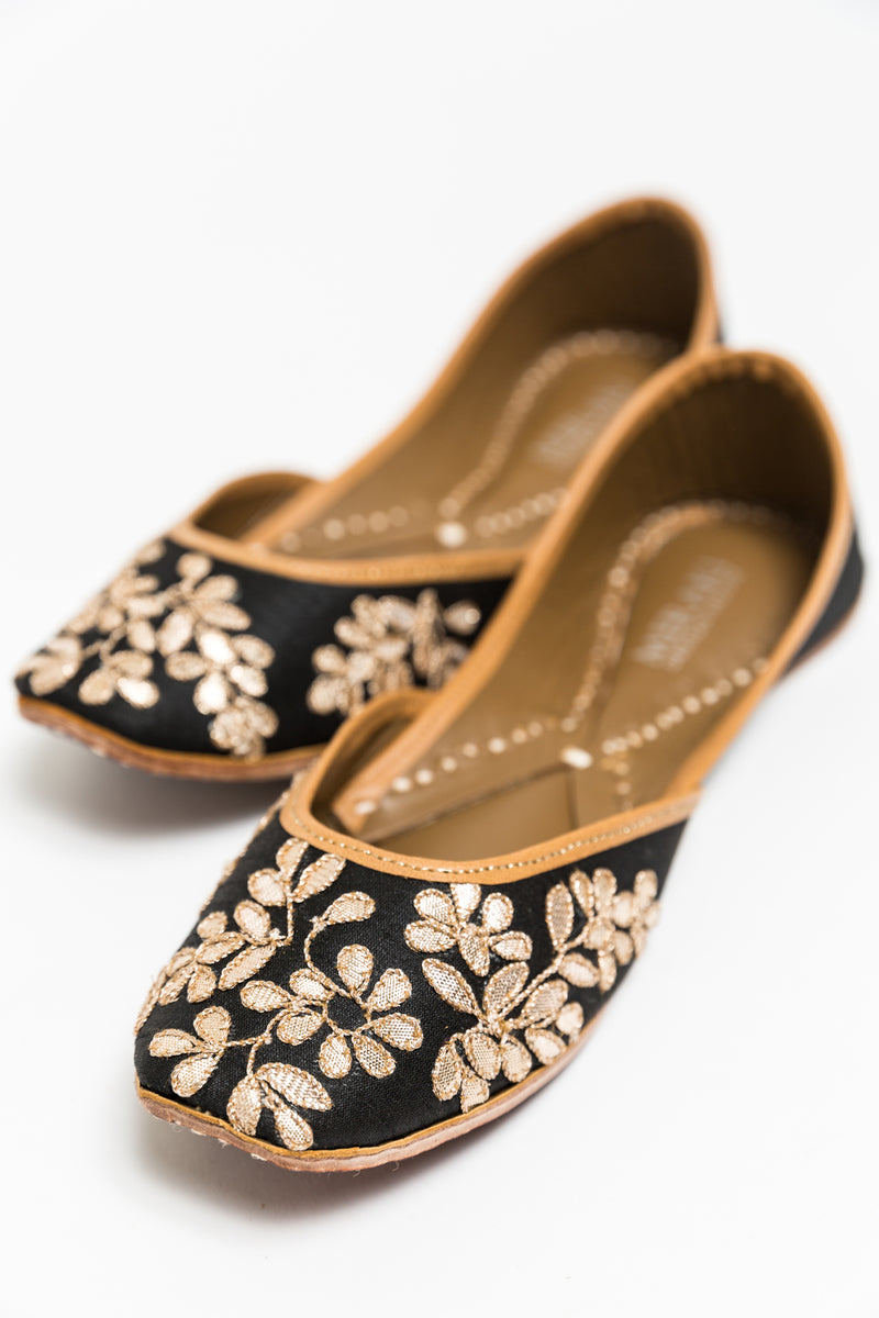 Handcrafted black flats, inspired by South Asian Khussa/Jutti design. Made with 100% genuine leather. Comfortable fancy flats perfect for any occasion. A classic black flat, with golden gota that goes perfectly with every outfit in your wardrobe.